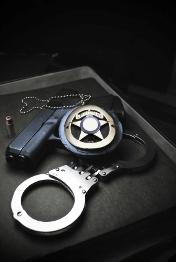 Badge and gun